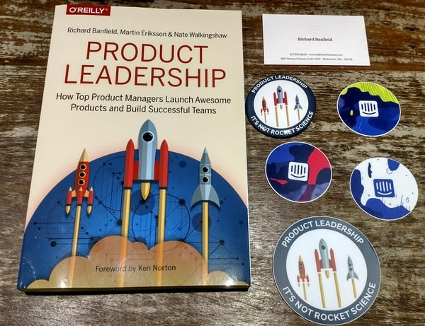 Product Leadership Book and Intercom stickers